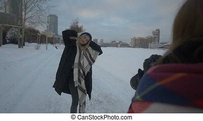 Girl posing on the street in winter