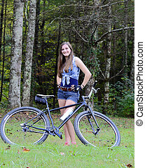 Girl Posing with Bicycle