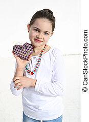 Girl posing with handmade toy