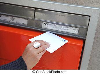 girl posting a letter