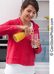 Girl pouring orange juice