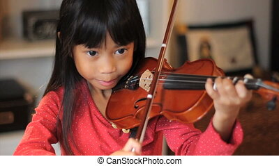 Girl Practices Her Violin-High Angl