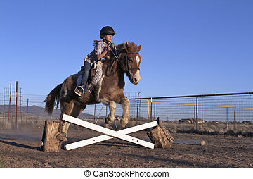 Girl Practicing Jumps with Horse