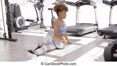 Girl practicing yoga in gym - Young fit woman in sportswear...