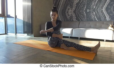 Girl practicing yoga in the living room