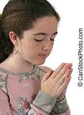 Girl Praying 2 - A teenaged girl with her hands folded in...