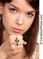 Girl praying hands with a cross