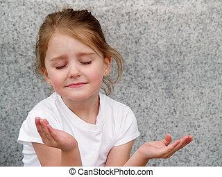 girl praying - little girl with upturned hands as in prayer...