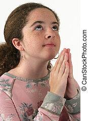Girl Praying - A teenaged girl, hands folded in prayer,...