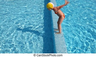 Girl prepared and jumped into the water, came back and did it again