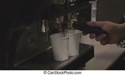girl prepares coffee in coffee machine
