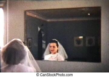 A beautiful teenage girl prepares for her first communion after her confirmation classes are finished. (Scan from archival 8mm film)