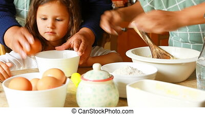 Girl preparing food with family in kitchen 4k