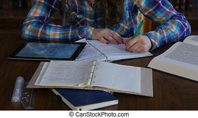 Girl preparing for exams in University. Writes in a notebook. 4K