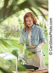Girl preparing soil for planting