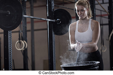Girl preparing to weightlifting - Horizontal view of girl...