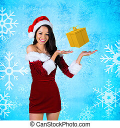 Girl presenting in santa outfit