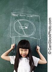 no smoking - girl pretend holding a no smoking sign on black...