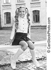 Girl primary school pupil happy going to school, formal education concept.