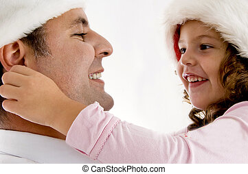 girl pulling father\\\'s ea