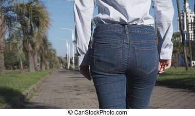 girl pulls from the jeans pocket stack of bills