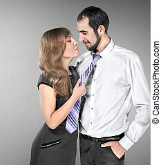 girl pulls the guy for a tie