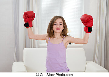 Girl Punching With Boxing Gloves