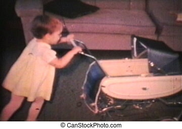 Girl Pushes Dolly In Stroller 1968