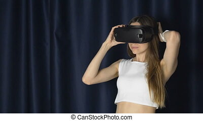 Girl Puts on VR Helm - Dark hair caucasian girl putting on...
