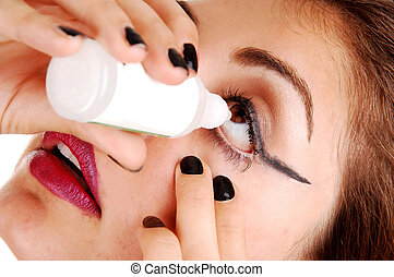 Girl putting eye drops.