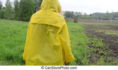 girl rain grass coat