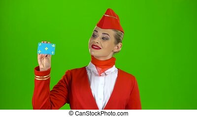 Girl raises a card and shows a finger up. Green screen -...