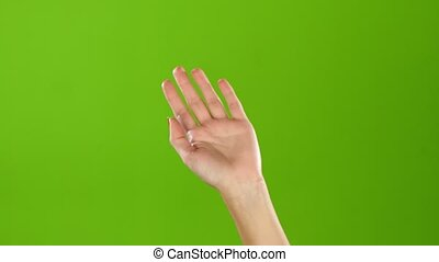 Girl raises hand up and waved everyone goodbye. Green screen...