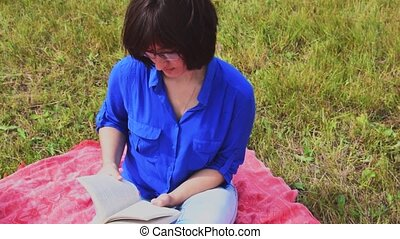 Girl reading a book outdoor