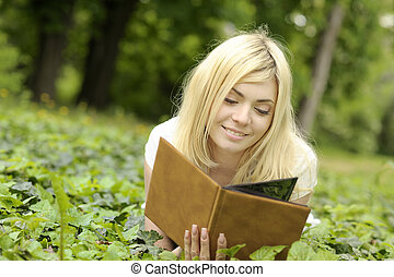 Girl reading a book outdoor.