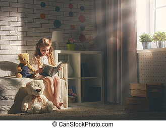 girl reading a book - Cute little child girl reading a book....
