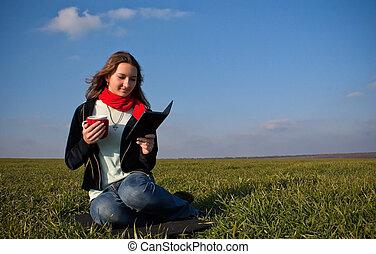Girl reading a e-book