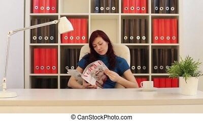 Girl Reading A Magazine In The Office