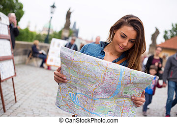Girl reading a map