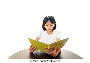 Girl reading at desk