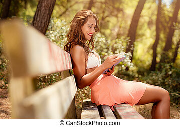 Girl Reading Book In Forest