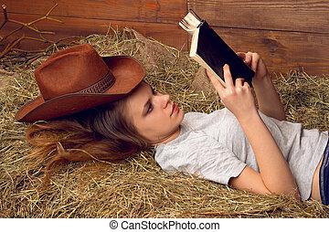 Girl reading book in loft