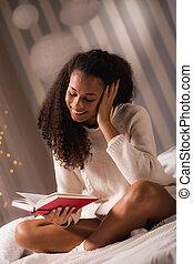 Girl reading funny book