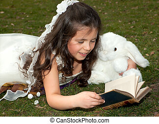 Girl reading in garden