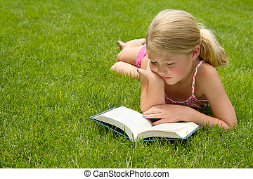 Girl reading in the grass