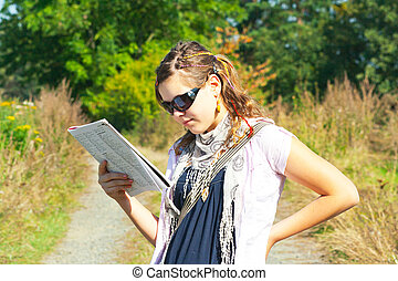 Girl reading in the wild