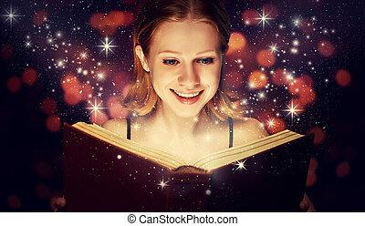 girl reading  magic book - girl reading a magic book