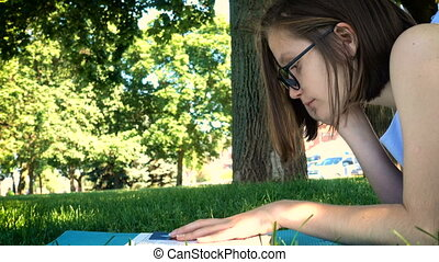 girl reading on a grass