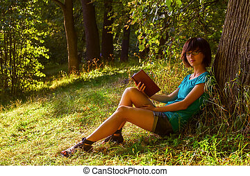 Girl reading on the nature