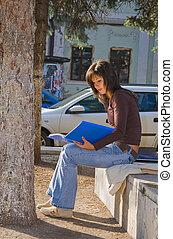 Girl reading outdoor